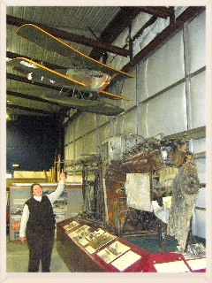 Diane at the Alaska Aviation Heritage Museum with the remains of the original Seattle