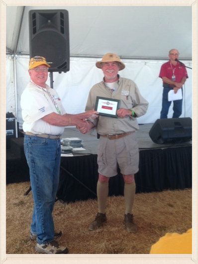 Bob receives the award at the Exhibits tent after the air show.