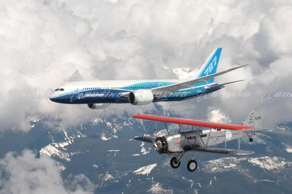 Past and Present. The prototype 787 flies formation with the Addison Pemberton's Model 40. This Model 40 is the oldest airworthy Boeing aircraft.  (Boeing Images)