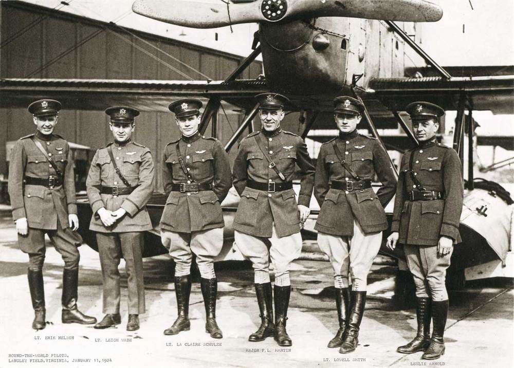 Some members of the flight pose with one of the aircraft.  (San Diego Air & Space Museum)