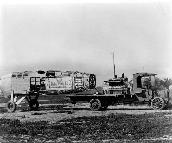 The partially assembled Cloudster being towed by a truck. The engine is on the bed of the truck.  (San Diego Air & Space Museum)