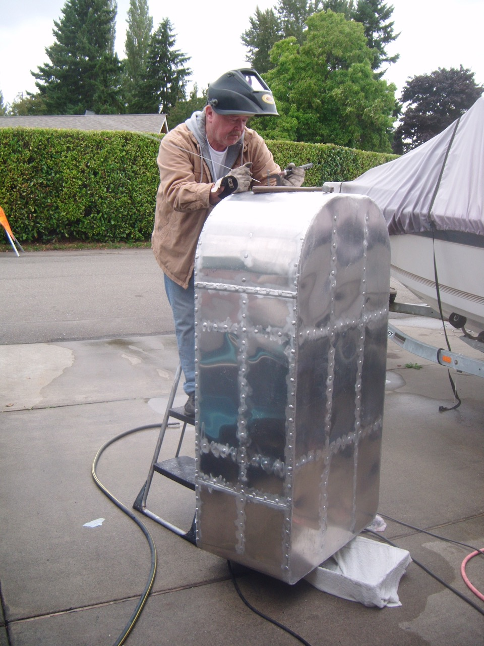 Gary working on one of the Seattle II's fuel tanks.