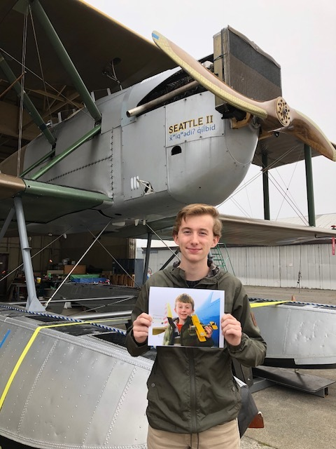 A number of years ago Ryan Zulauf, former Renton Airport Manager, and his son Cole built a model of a World Cruiser. Cole recently stopped by the hangar to visit with us and share this great photo of he and the model they built.