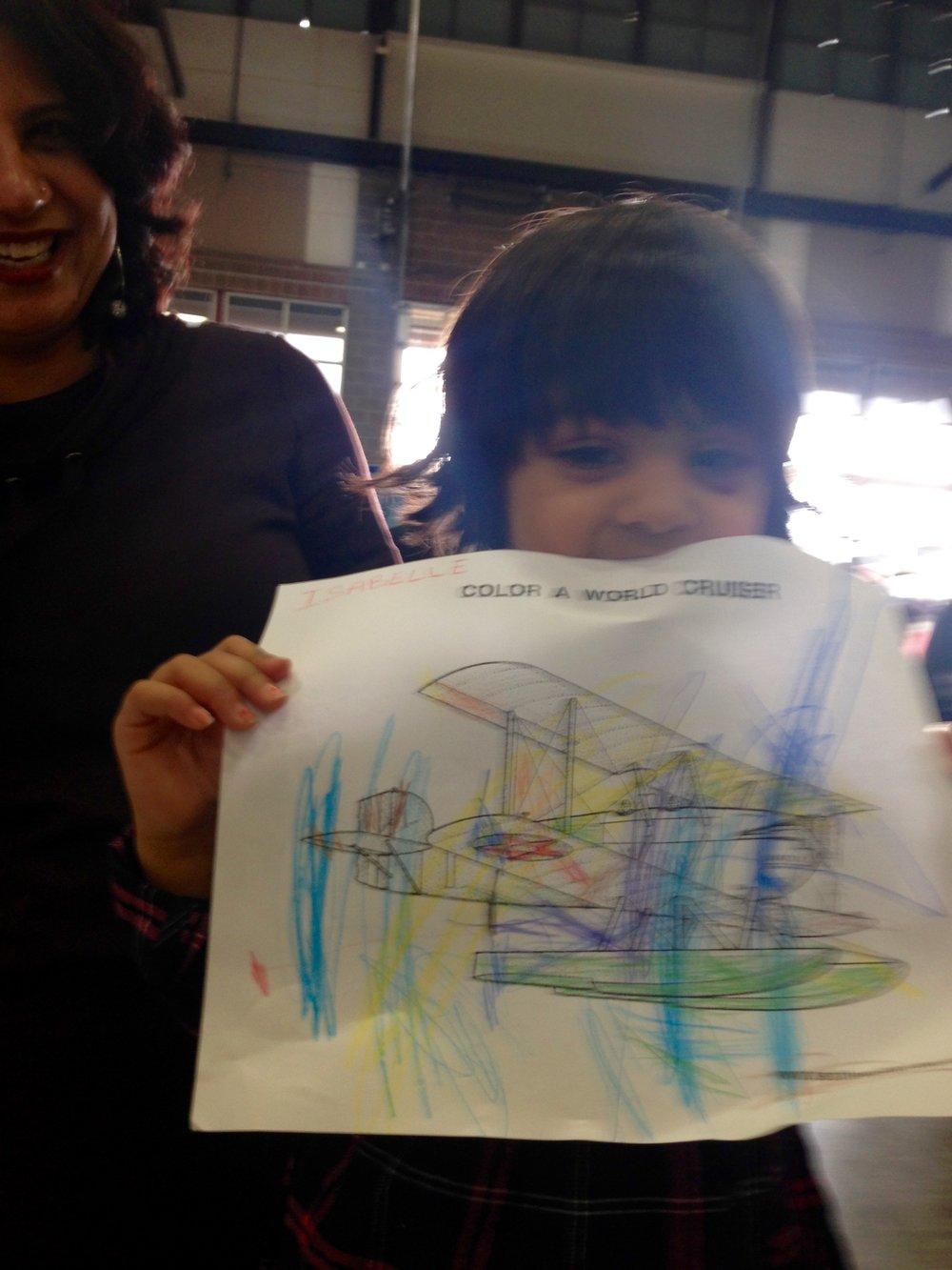Isabelle shows off her wonderful artwork.