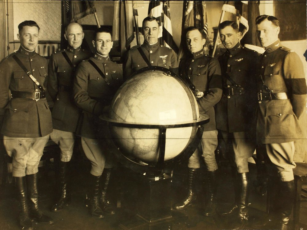 The World Flight Crews (Left to Right): Lt. Jack Harding, Lt. Erik Nelson, Lt. Leigh Wade, Maj. Frederick Martin,Lt. Lowell Smith, First Lt. Leslie Arnold and Lt. Le Clair Smith. They are wearing black arm bands in honor of former U.S. president Woodrow Wilson, who had recently passed away.