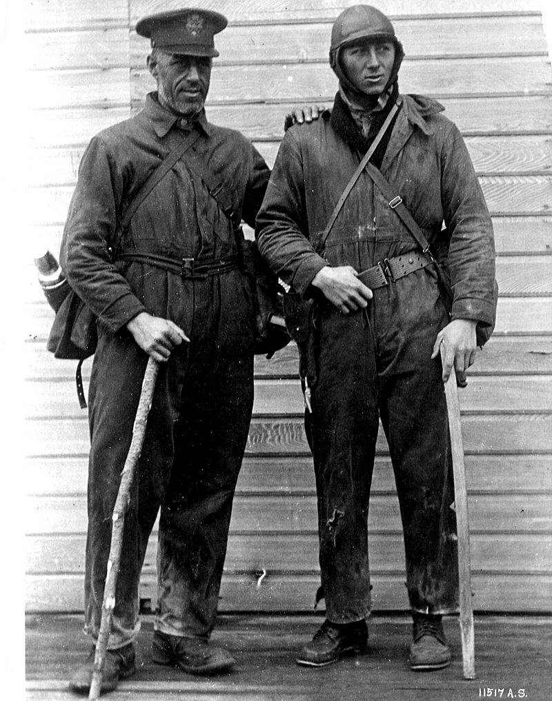 The original caption reads: Major F. L. Martin and Sgt. Harvey, taken on return to civilization after being lost in Alaska for 10 days when plane crashed into the side of a mountain. (342-FH-3B-7971-11517AS)