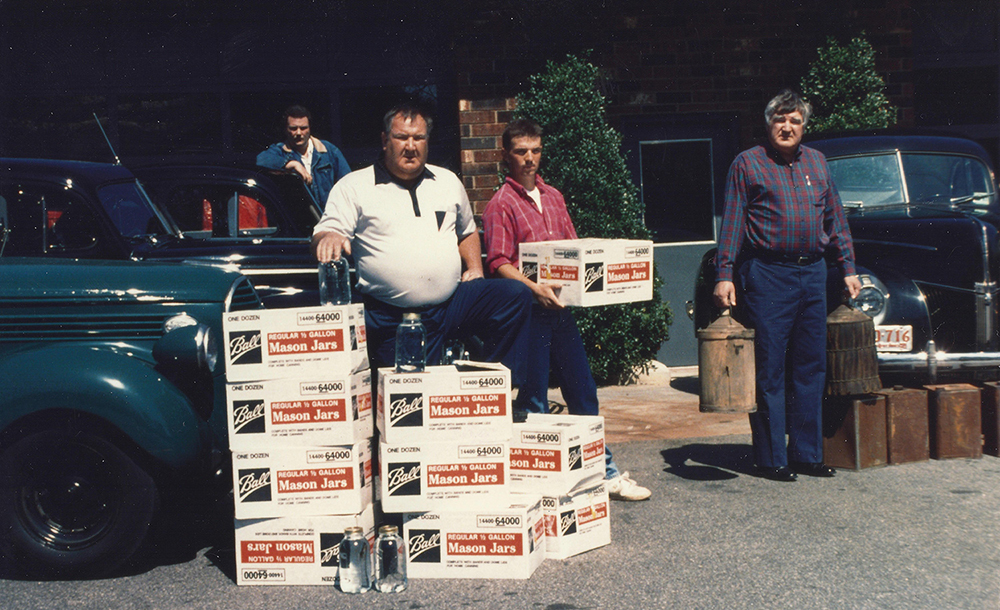 The Call Boys. Brian Call (current Head Distiller) pictured here holding a case of shine.