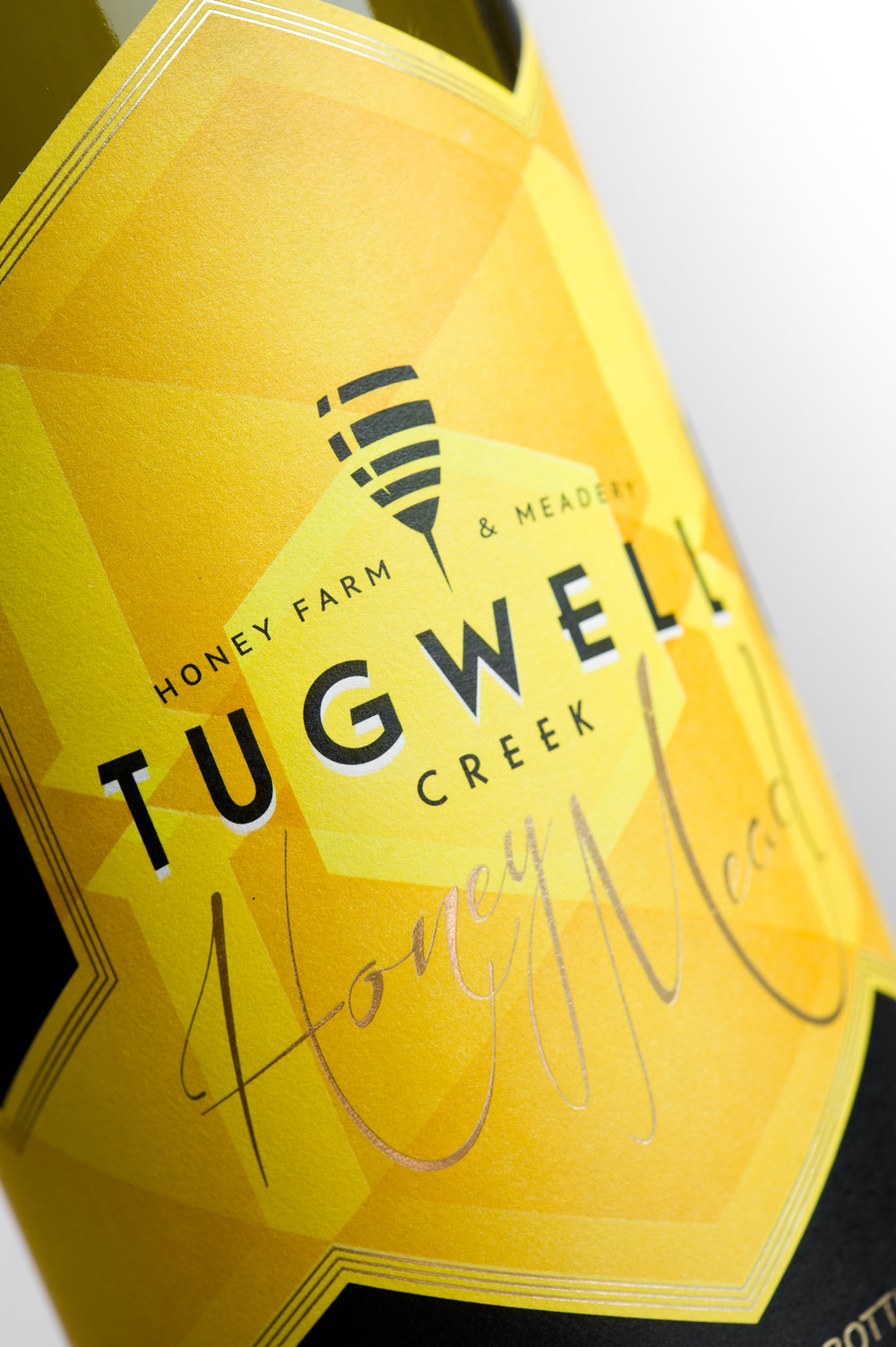 Hired Guns Creative was brought in to create a new brand and label design for Tugwell Creek Honey Farm & Meadery, the oldest honey farm and meadery on Vancouver Island. Dissatisfied with their old labels, the team at Tugwell Creek wanted a design that more accurately reflected their operation, philosophy, and products.  The end result is a clever, versatile identity that positions them very firmly as a wine competitor, yet distinctly apart from wineries; and a bright, vivid label that has substantially increased their shelf presence in wine shops.
