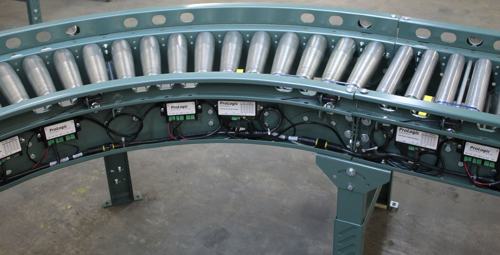 A string of conveyor belts with controllers.