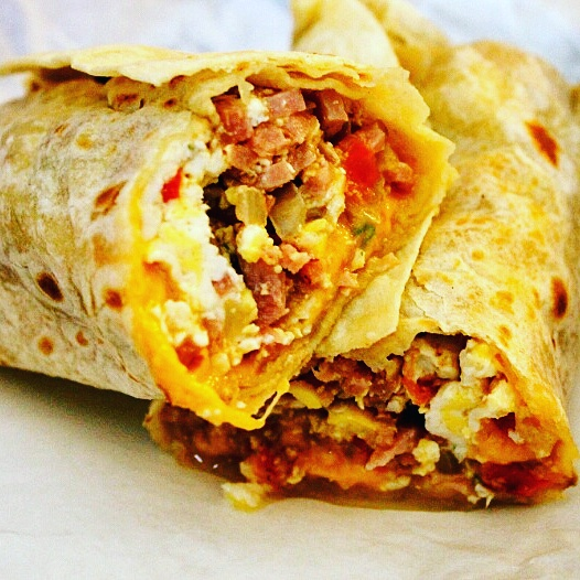 Breakfast Burrito with Green Peppers, Onions, Mushroom, garlic hash brown and choice of sausage or bacon.