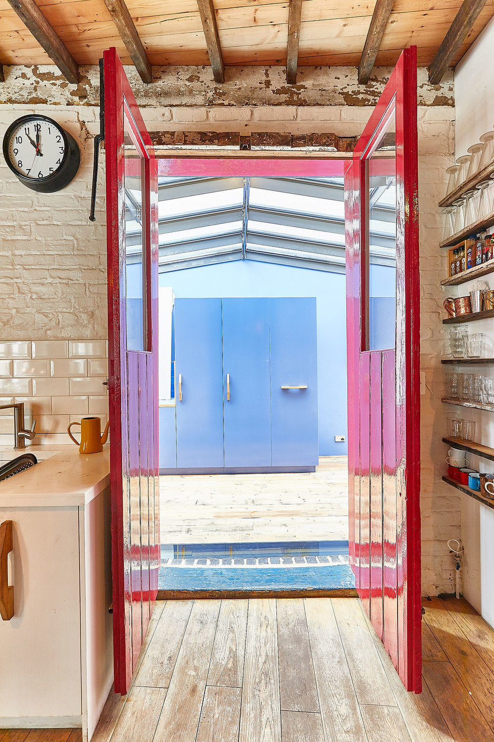Entrance from the house's kitchen into the new extension