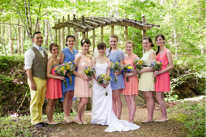 A colorful, intimate rustic wedding on the Ocoee River in Southern Tennessee. The bride and groom perform a song together during the reception, and the bridesmaids wear colorful mis-matched gowns. Click through to see the rest of the beautiful photos! @paperswalloweve
