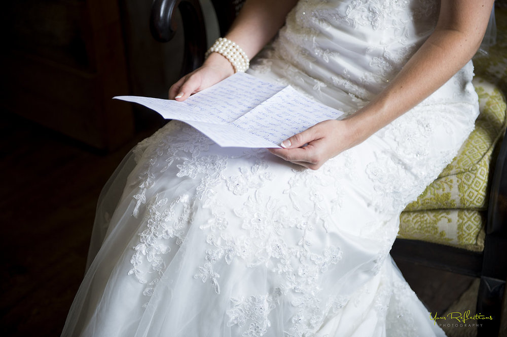 bride reads letter from her groom.jpg