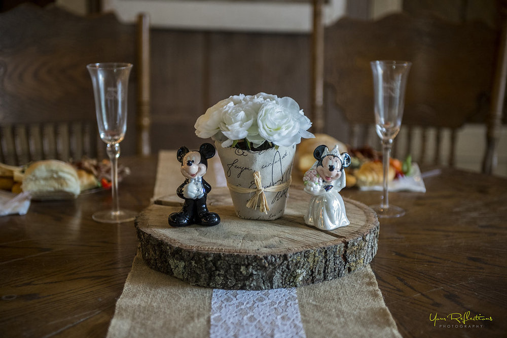 bride and groom mickey and minnie head table.jpg