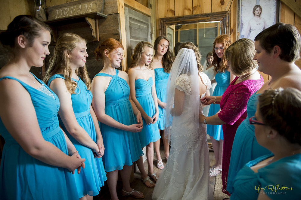 Bride getting ready with her bridesmaids 1.jpg