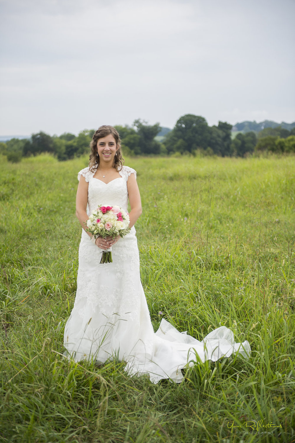 bride standing in field.jpg