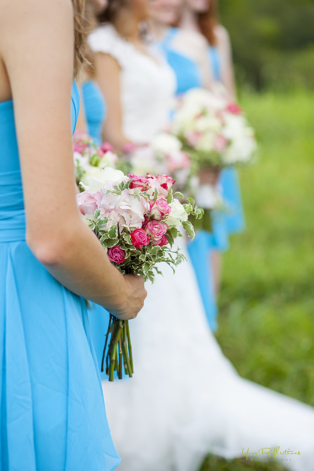 bridesmaids in blue holding thier bouquets.jpg