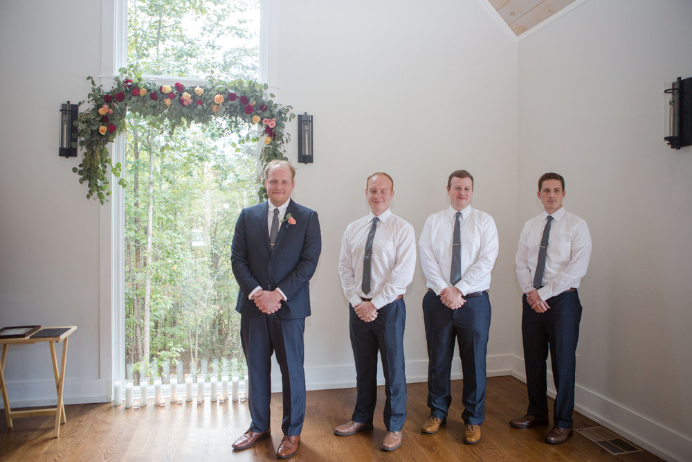 Chris + Meghan's Georgia wedding was bright and joyful. From the men's navy suits to the bridesmaids' dusty blue dresses and the subtle pops of blush everywhere, this wedding was a southern delight and all about the details! Photographer: SmmS Photography, Coordination: @PaperSwallowEve, Venue: Juliette Chapel in Dahlonega, Georgia