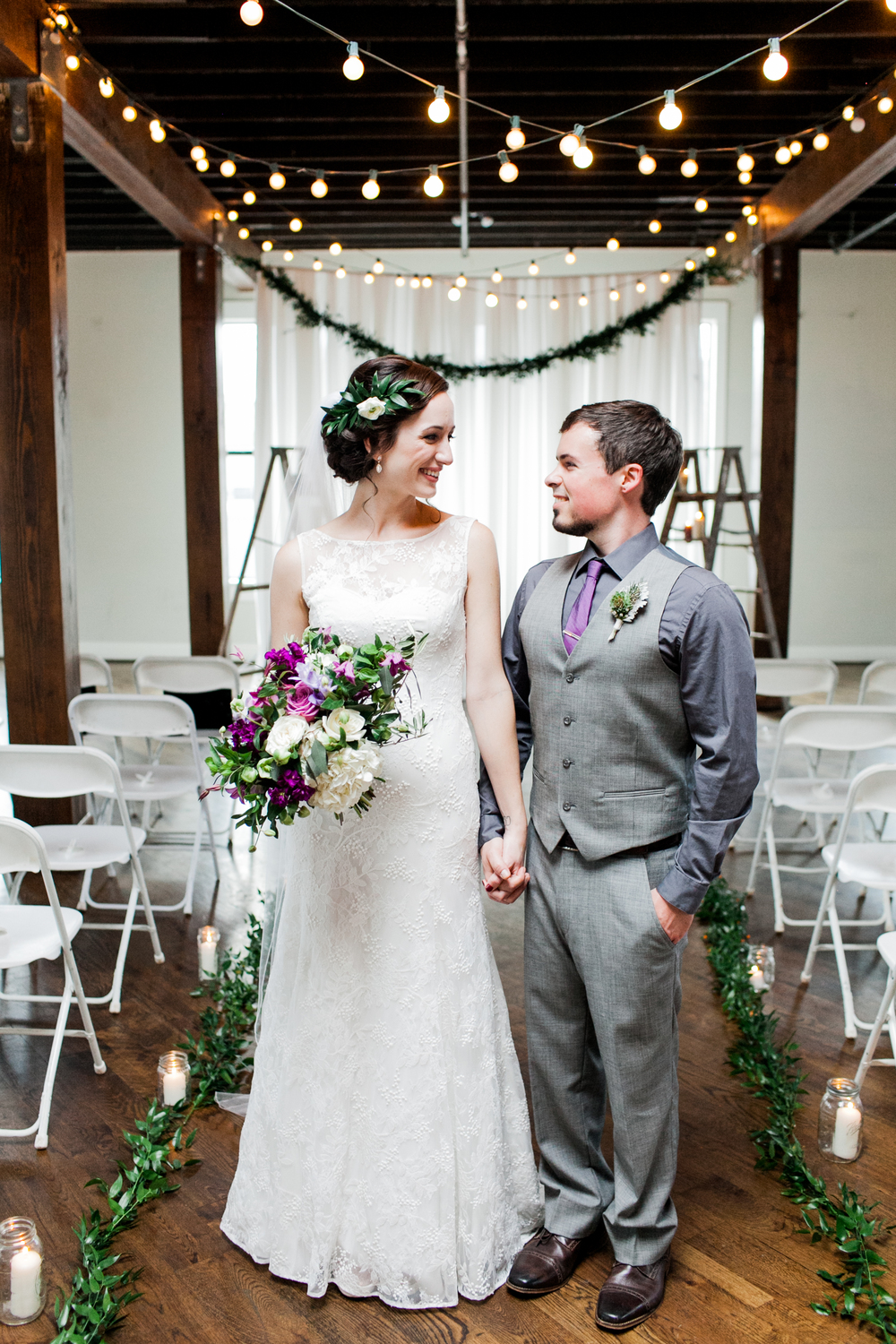 Ally + Zach's joyfilled, fall wedding in Birmingham, Alabama. Pops of purple, white, green and gold. The venues were the beautiful upstairs of the of the Avondale Brewery and the historic outdoor venue of the Avondale Villa. This was a wedding full of memorials, special moments, lots of friendship, love and laughter with reception decor that looks a little bit like it might belong in Harry Potter's Hogwarts. Planned + Designed by @PaperSwallowEve, Photography by Mary Margaret Smith, Flowers by Hot House Design Studio + Paper Swallow Events, Donuts by the Heavenly Donut Co and live music from the Goat Hill String Band.