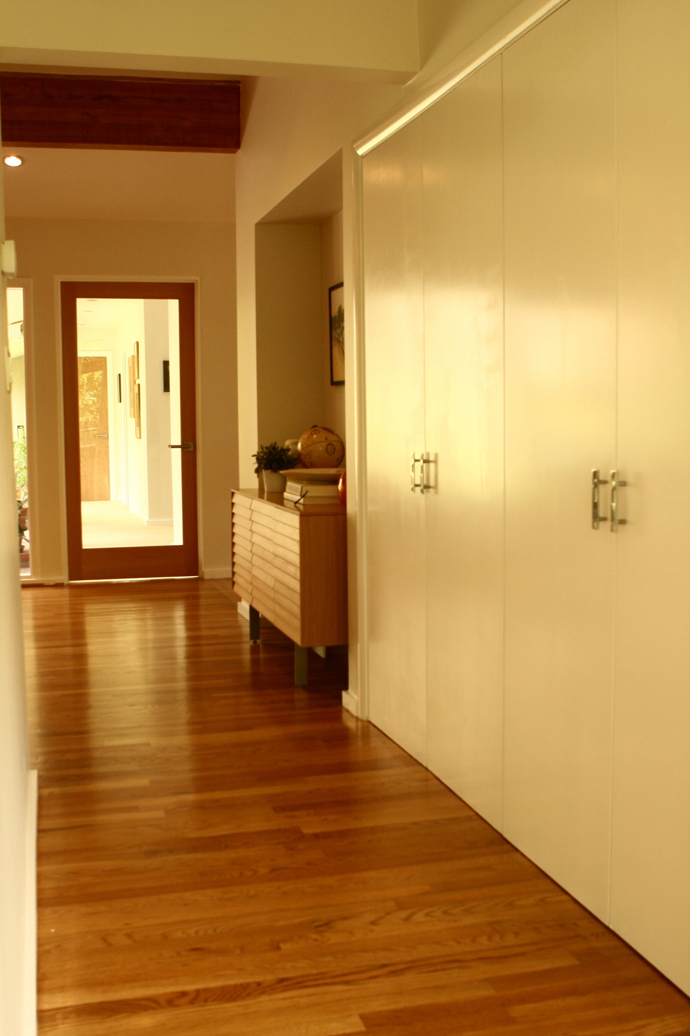 The addition of the glass door lets all the natural light flood in, while keeping the kids' hallway quiet when needed.