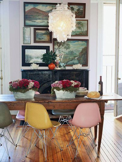 -mixed-colored Eames Molded Fiberglass (Wire-Base) chairs balance out a very traditional setting, via Apartment Therapy