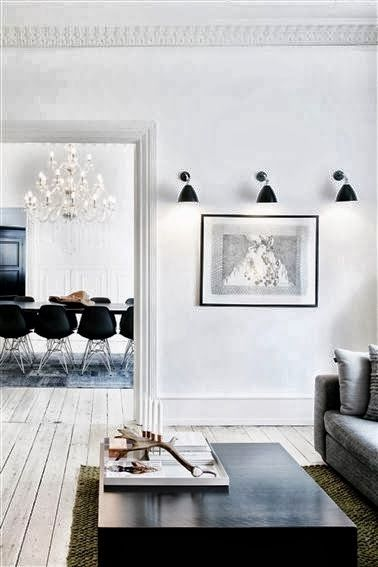 -via coolechicstylefashion.blogspot.com - this room uses very cool-toned whites and grays, along with black...the chandelier adds a glam factor above the modern dining chairs.