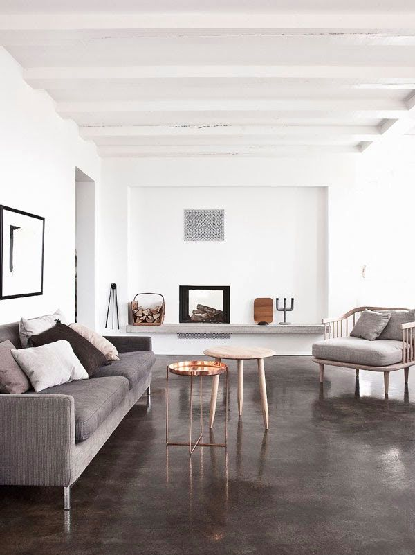 "-via Apartment 34 - the polished concrete floor adds shine and complements the gray upholstery. The copper table breaks it up without using ""color""."