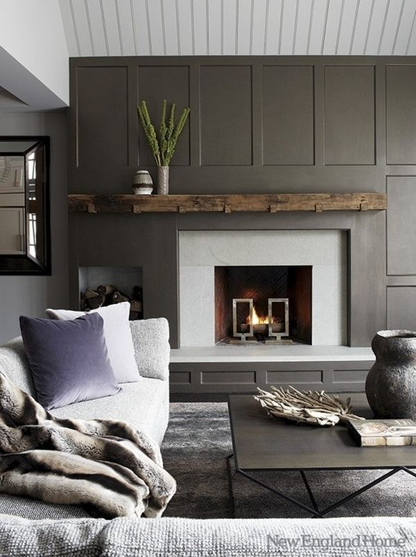 -via New England Home / The dark panel surround is really interesting - love the wood cubby on the left.  The stone is nice, too.  I'll stop pointing out seams now (!), but isn't it fascinating how obvious they are once you're looking for them?  The rustic mantel is a great touch.
