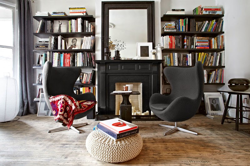 -home of architect Stephane Chamard, via Daily Dream Decor / The black is a nice change.  I really dig the full bookshelves and the Arne Jacobsen Egg Chairs.  Looks like a dreamy place to curl up and read a book.