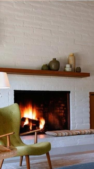 -via remodelista.com / The simple, wood mantel is the perfect touch for this style.