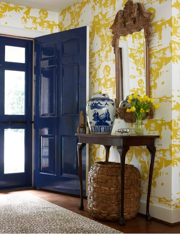 -via blog.purehome.com / I love the combination of the bright blue lacquered door with the yellow and white wallpaper.