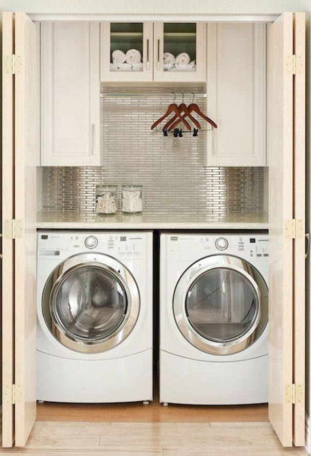 -via urumix.com / This attractive, little laundry room all fits into a small closet. The addition of a floating counter, cabinets and a clothing rod make it very functional, as well.