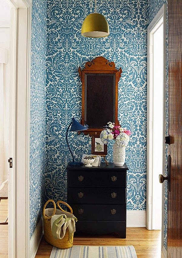 -via thehuntedinterior.com / The use of wallpaper and a small chest of drawers makes this an eye-catching, little foyer.