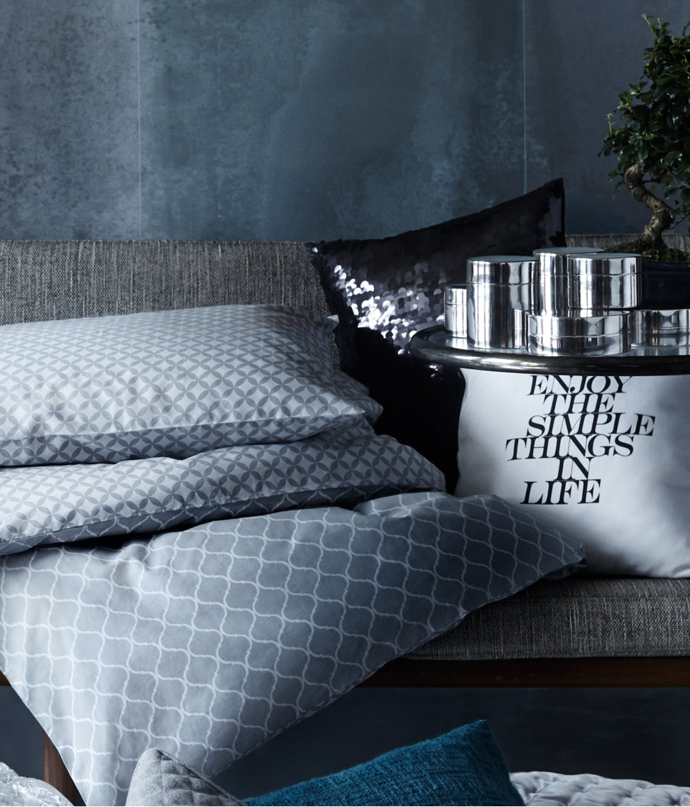 -via H&M home / Gray, white, black, blue...the varying patterns and textures, and the addition of text, make this combination totally work.