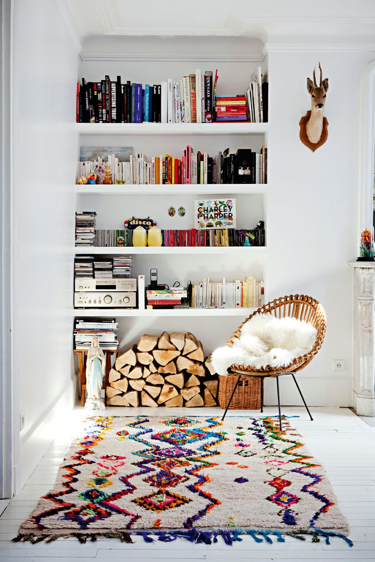 -via milkmagazine.net / I love the casual look of this one.  The wood underneath is great, and the rug plays off the objects and books perfectly (imperfectly)!