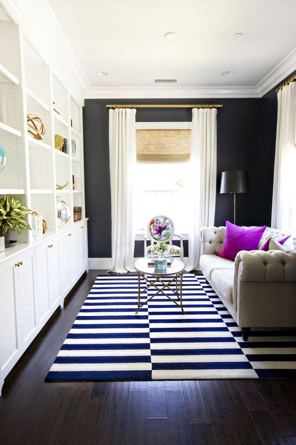 -via stylemepretty.com / What a killer room!  Love the rug, the black wall and especially those fab pillows!