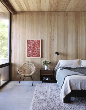 -via House Beautiful / Notice how the vertical wood just flows into the ceiling.