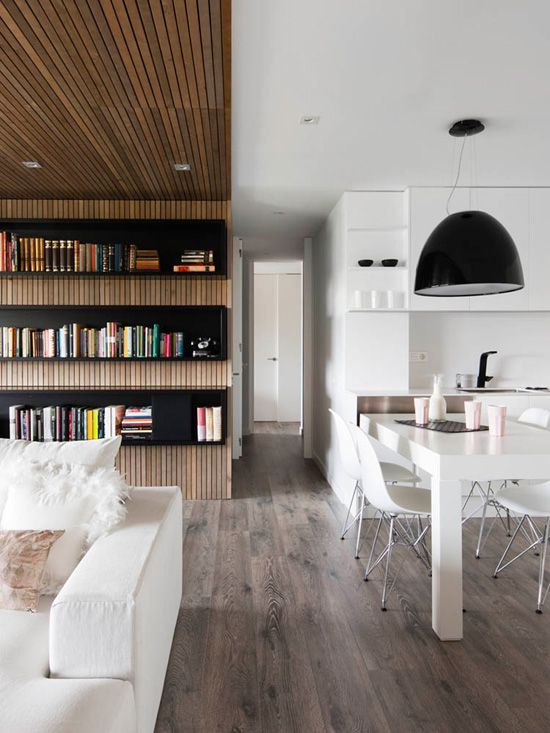 -via desiretoinspire.net / The contrast with the white is dramatic, but I'm not sure I love it with those ashy wood floors.