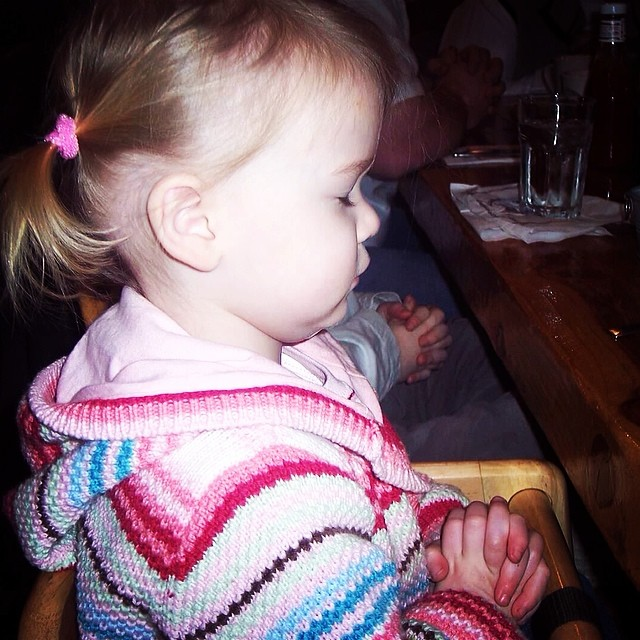 This is my daughter praying before a meal. Photo Credits go to Uncle Cammy.