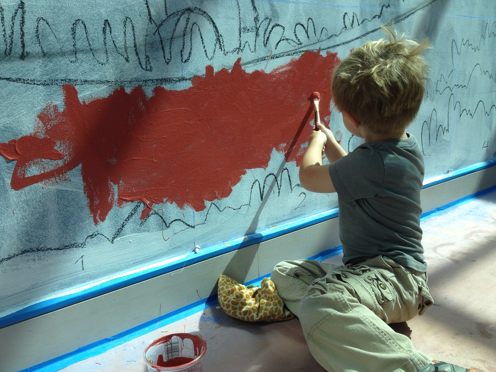 Dante helping paint at the MAH.