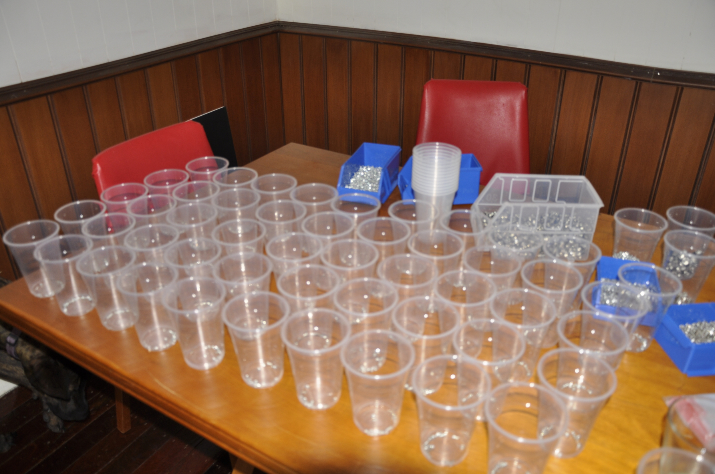 Plastic cups slowly filling up with parts before we put them into bags.