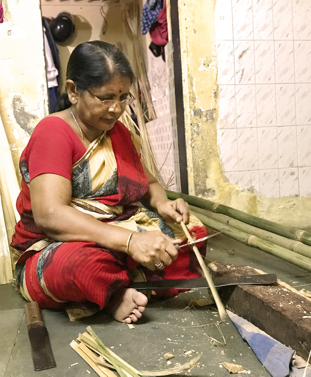 Gangamma shows us how to make bamboo sticks.