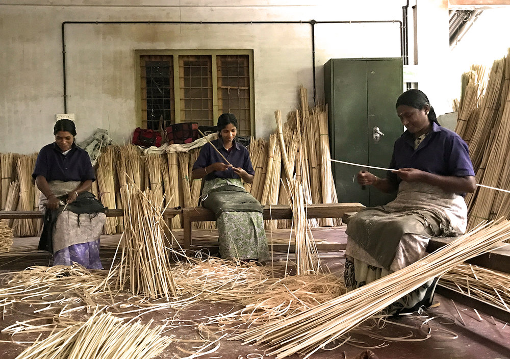 Preparing bamboo sticks.