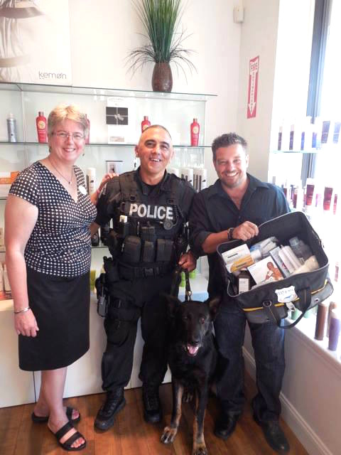 Kathy Hinds, Ofc. Joe Papsedero and K-9 Havoc (Burlington Police Department) and Anthony Vitale at a fundraiser held at Anthony David Salon. Vitale holds a K9 First Aid Kit.  PHOTO: Florence Tambone
