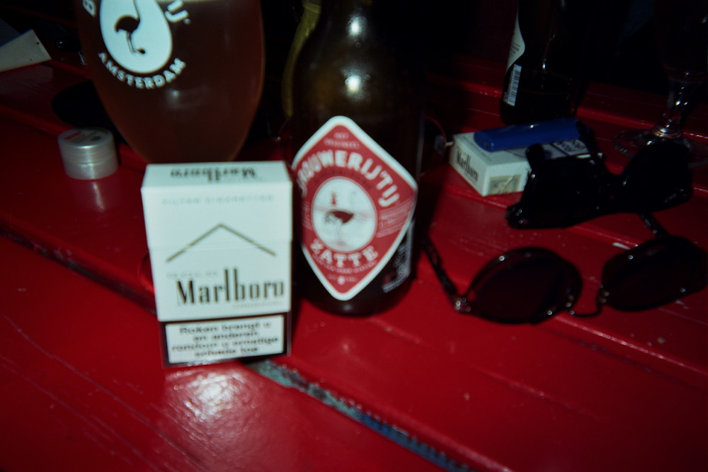 This evening would start out like any other. Sun, Marlboros, and my cheap shit sunglasses from the thrift store. We're gonna live cheap, but we're gonna live big. After all, art students don't get paid much. But we sure have more fun.