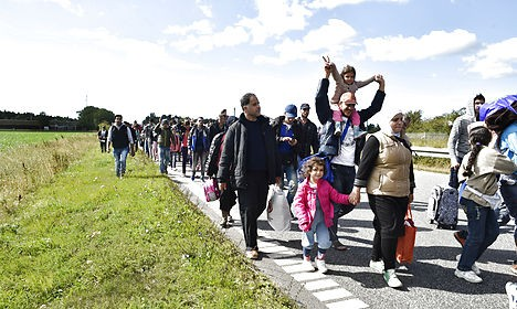 Refugees attempting to walk over 150 km from Rødby in Denmark to Malmö in Sweden. Photo: Bax Lindhardt/Scanpix