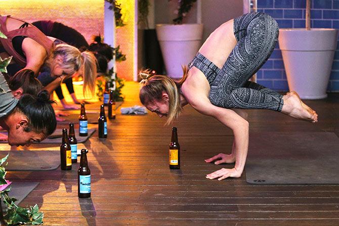 "Organic Craft Beer Yoga – ""Drunk crow pose"" Photo:  rediff.com"
