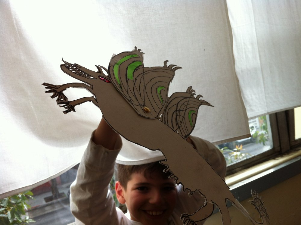 Make MOVABLE PAPER PUPPETSwith cardboard and colored cellophane.