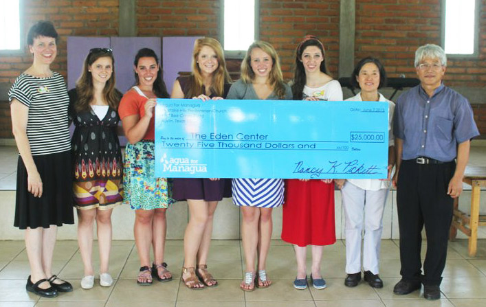 Agua for Managua founders giving the Eden Center a $25,000 check for the first project, largely funded from members of their own church, t-shirt sales and bake sales.