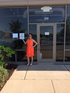 Jennifer Stockhausen rockin' her first building permit in her tangerine power dress.